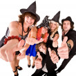 Group of in witch costume with thumbs up. — Stock Photo