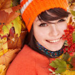 图库照片: Girl in autumn orange leaves.