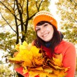 Girl in autumn orange hat with leaf group near tree. — Stock Photo #3916815