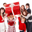Happy family with red gift box. — Stock Photo