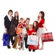 Happy family with children and shopping bag. — Stock Photo