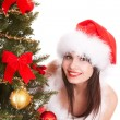 Christmas girl in santa hat with fir tree. — Stok fotoğraf