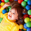 Happy child in group colourful ball. — Stock Photo