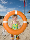 Childl with life buoy at coast. — Stock Photo