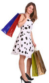 Woman carrying shopping bags and boxes. — Stock Photo
