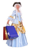 Woman in period dress with shopping bags. — Stock Photo