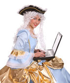 Woman with laptop in period dress. — Stock Photo