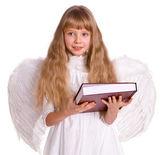 Ragazza in costume da angelo con libro. — Foto Stock
