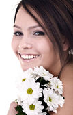 Beautiful young with flower looking. — Stock Photo