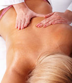 Massage of female back. — Stock Photo