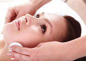 Beautiful young woman in spa. Facial — Stock Photo