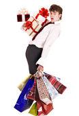 Mann mit sinkenden gruppe-geschenk-box und einkaufstasche. — Stockfoto