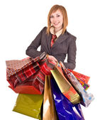 Businesswomen with group of bag. — Stock Photo