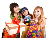 Three beautifu girlfriends enjoy shopping. — Stock Photo