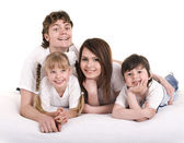 Happy family: mother, father, daughter, son. — Stock Photo
