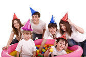 Happy family with children in party hat. — Stock Photo