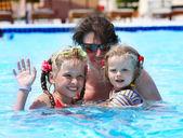 Happy family in swimming pool. — Stock Photo