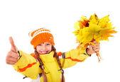 Child in autumn orange hat holding leaves thumb up. — Stock Photo