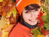 Girl in autumn orange leaves. — Stockfoto