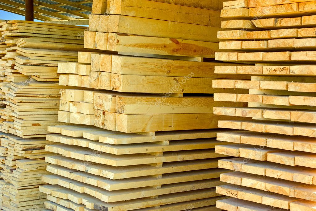 Assorted stacked lumber on stock of commercial timber  Stock Photo #3474159