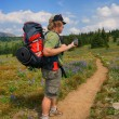Hiker checks GPS — Photo