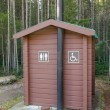 Campsite outhouse - Stock Photo