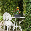 Wrought iron garden  table and chair - Stock Photo