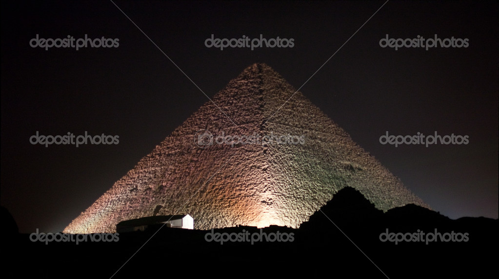 Giza Pyramids and sphinx illuminated by colored lights at night — Lizenzfreies Foto #2825750