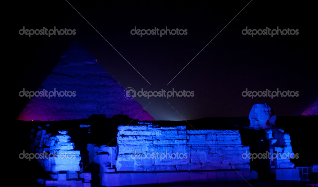 Giza Pyramids and sphinx illuminated by colored lights at night — Stock Photo #2825753