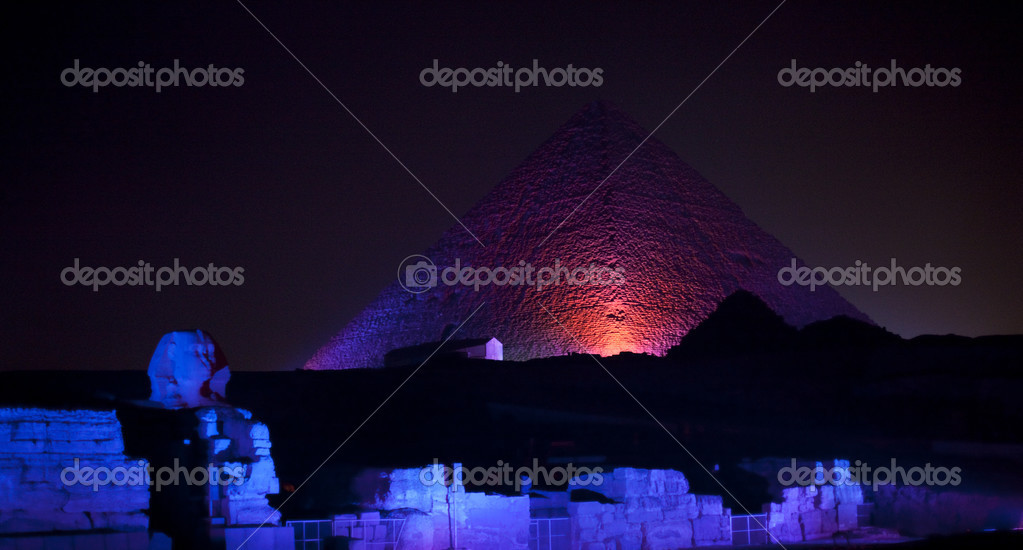 Giza Pyramids and sphinx illuminated by colored lights at night — Stock Photo #2825755