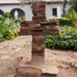 Stock Photo: Old brick cross in Mission