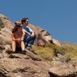 Hikers in desert look at distant object — Stock Photo