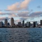 Orange clouds reflect light from San Diego Skyline — Stock Photo