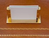 Brass business card holder — Stock Photo