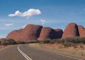 Ayer's Rock with road — ストック写真