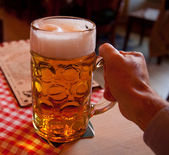 Liter glass of beer in hand — Stock Photo