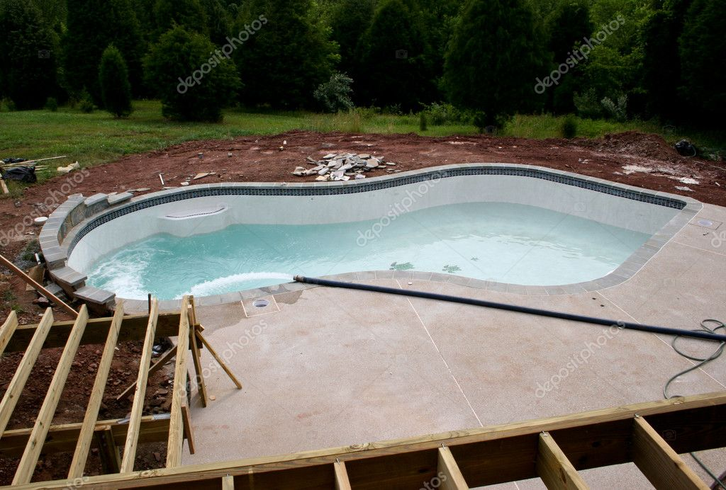 Early stages of building a pool stock photo steveheap for Building a pool