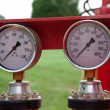 Pair of pressure gauges - Stock Photo