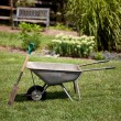 Wheelbarrow and spade — Stock Photo