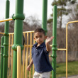 Stock Photo: Multi-racial boy at playground