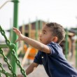 Multi-racial boy at the park - Stock Photo
