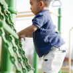 Multi-racial boy at the park — Stock Photo