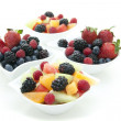 Berries and fruit in bowls — Stock Photo