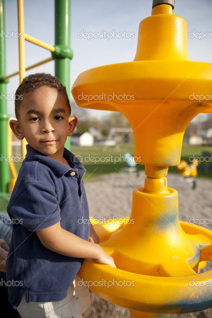 Cute multi-racial boy at the park playing. — Stock Photo #3580093