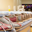 Stock Photo: Pairs of bowling shoes lined up in shoe rack