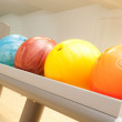 Bowling balls in a row — Stock Photo