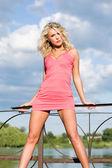 Pretty girl in pink dress. — Stock Photo