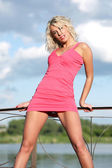 Pretty girl in pink dress. — Stockfoto