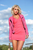 The young woman in pink clothes. — Stock Photo