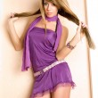 Yong woman in a violet dress. — Stock Photo